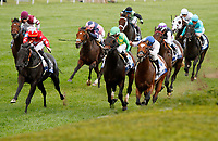 """LEXINGTON, KY - October 7, 2017. #3 Suedois (FR) and jockey Daniel Tudhope (front left with grey star on red cap) win the 32nd Shadwell Turf Mile, Grade 1, $1,000,000 """"Win and You're In Breeders' Cup Turf Mile"""" for owner George Turner and Clipper Logistics (Steve Parkin) and trainer David O'Meara at Keeneland Race Course.  Lexington, Kentucky. (Photo by Candice Chavez/Eclipse Sportswire/Getty Images)"""