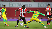 Josh DaSilva of Brentford takes on West Brom's Filip Krovinovic during Brentford vs West Bromwich Albion, Sky Bet EFL Championship Football at Griffin Park on 26th June 2020