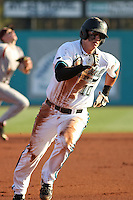 Scott Woodward #10 of the Coastal Carolina University Chanticleers running the bases against the Boston College Eagles at Watson Stadium at Vrooman Field in Conway, South Carolina on February 18, 2011. Photo by Robert Gurganus/Four Seam Images