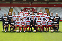 Stevenage FC 12/13.Front row l-r: Luke Disney. (physio intern), Mark Newson (assistant manager), Luke Freeman, David Gray, Anthony Grant, Gary Smith (manager), Mark Roberts, Don Cowan, Lucas Akins , Gary Phillips (goalkeeping coach)<br />