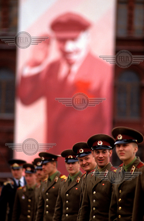 © Paul Lowe / Panos Pictures..Moscow, RUSSIA. 09/05/1990...Soldiers beneath a portrait of Lenin at the Victory Day parade, an annual event marking the anniversary of the Soviet victory over Germany in 1945.