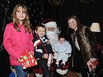 Hannah Fitzgerald, Eoin, Ruarí and Niamh Commins pictured with Santa at Ballapoosta christmas fair. Photo: Colin Bell/pressphotos.ie