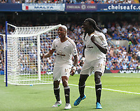 Bafetimbi Gomis of Swansea celebrates scoring his sides second goal with team-mate  Andre Ayew of Swansea   during the Barclays Premier League match between  Chelsea and Swansea  played at Stamford Bridge, London