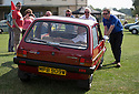 26/07/14 <br /> <br /> Princess Diana's Mini Metro is pushed into position ahead of the judging.<br /> <br /> Princess Diana's Mini Metro was the star of the show at the first ever Festival of the Unexceptional.<br /> <br /> The car show held near Silverstone celebrated the best examples of the most ordinary cars of late 1960s to mid-1980s Britain.<br /> <br /> Organisers, Hagerty Insurance, said: &quot;Let&rsquo;s celebrate, preserve and enjoy these threatened and endangered pieces of our beige, brown and plaid automotive heritage.<br /> <br />  &quot;There are twice as many Ferraris on the road in the UK than Austin Allegros! We&rsquo;ve brought together the 50 best examples of a wide range of models - an award of dubious value will go to the overall winner.&quot;<br /> <br /> Princess Diana's red 1980 Mini Metro L was photographed many times while she was dating Prince Charles and was affectionately known as the 'courting car'. It has had three owners since it left the Royal fleet, and has clocked-up a very modest 30,000 miles. <br /> <br /> <br /> All Rights Reserved - F Stop Press.  www.fstoppress.com. Tel: +44 (0)1335 300098