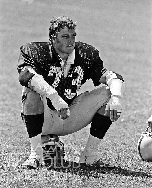 Oakland Raiders training camp August 10, 1982 at El Rancho Tropicana, Santa Rosa, California.   Oakland Raiders defensive end Dave Browning (73)