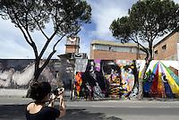 Roma, 4 Maggio 2014<br /> Il Muralista brasiliano Eduardo Kobra dipinge la facciata di Metropoliz in Via Prenestina con un mural dedicato a Malala.<br /> La ex fabbrica Fiorucci occupata da decine di famiglie ospita anche il MAAM , museo dell'altro e dell'altrove di Metropoliz.<br /> Brasilian street artist Eduardo Kobra, painting Malala's eyes in a occupied factory