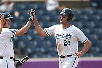 West Michigan Michigan Whitecaps first baseman Blaise Salter (24) is greeted by teammate Josh Lester after scoring against the Fort Wayne TinCaps during the Midwest League baseball game on April 26, 2017 at Fifth Third Ballpark in Comstock Park, Michigan. West Michigan defeated Fort Wayne 8-2. (Andrew Woolley/Four Seam Images via AP Images)