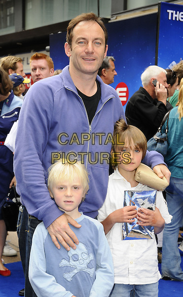 "JASON ISAACS & GUESTS .The ""Wall-E"" UK premiere, Empire Cinema, LEicester Square, London, England..July 13th, 2008.half length purple zipper zip up top jacket kids children white .CAP/CAN.©Can Nguyen/Capital Pictures."