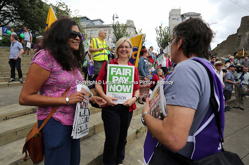 Swansea, UK. Thursday 10 July 2014<br /> Pictured: Socialist Party and Unison members at Castle Square Gardens, Swansea, south Wales.<br /> Re: Strikes are taking place across the UK in a series of disputes with the government over pay, pensions and cuts, with more than a million public sector workers expected to join the action.<br /> Firefighters, librarians and council staff are among those taking part from several trade unions, with rallies taking place across the UK.
