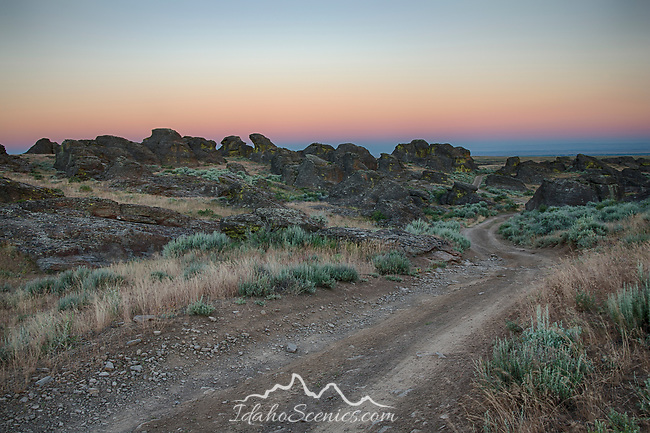 Idaho, South Central, Gooding. The road through Little City of Rocks in the evening twilight of late spring.
