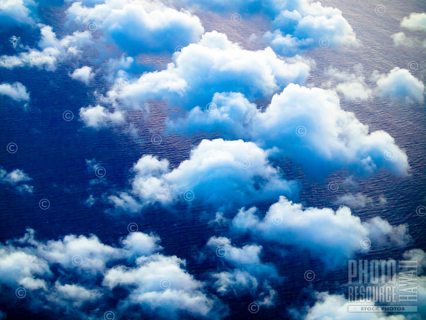 A bird's eye view of low-lying cumulus clouds over the 'Alenuihaha Channel between Maui and the Big Island.