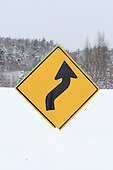 S in road ahead warning sign