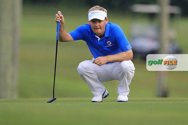 Soren Kjeldsen (DEN) Team Europe on the 1st green during Match 1 of Friday's Fourball Matches of the 2016 Eurasia Cup presented by DRB-HICOM, held at the Glenmarie Golf &amp; Country Club, Kuala Lumpur, Malaysia. 15th January 2016.<br /> Picture: Eoin Clarke | Golffile<br /> <br /> <br /> <br /> All photos usage must carry mandatory copyright credit (&copy; Golffile | Eoin Clarke)