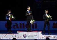 24th March 2018, Mediolanum Forum, Milan, Italy;  (L-R): Shoma UNO (JPN), Nathan CHEN (USA), Mikhail KOLYADA (RUS) during the ISU World Figure Skating Championships, men final medal ceremony at Mediolanum Forum in Milan, Italy