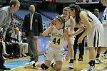 Bishop McGuinness' Cameron Nieters (44) is shaken up after a collision during the Villains' 60-44 win, a 7th-consecutive state title and a new state record, over Southside High School at the Dean Smith Center in Chapel Hill, NC, on Saturday, March 10, 2012.  Photo by Ted Richardson