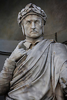 "Detail of statue of Dante, 16th century, on the facade of the Uffizi Gallery, Florence, Tuscany, Italy, pictured on June 10, 2007, in the morning. This statue of Dante Alighieri (1265-1321), poet, author of ""The Divine Comedy"" is one of a gallery of sculptures of eminent Italian men whose works in the arts and sciences are remembered today. Florence, capital of Tuscany, is world famous for its Renaissance art and architecture. Its historical centre was declared a UNESCO World Heritage Site in 1982. Picture by Manuel Cohen"