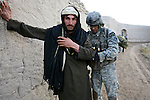 Cpl. Michael Ingram, 22, of Monroe, Mich., a soldier with Company C, 1st Battalion, 12th Infantry Regiment, checks a man for weapons in the village of Pashmul in Kandahar province, Afghanistan. Although villagers seemed friendly, the soldiers say they must take precautions because of frequent attacks by Taliban fighters in the area. Nov. 24, 2009. DREW BROWN/STARS AND STRIPES