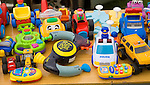 Children's plastic toys on display at a car boot sale, UK