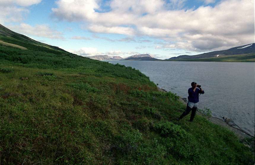039078.AA.0820.warming19.kc--Bering Sea, Off Providenya, Russia--Taking in the scenery along the mountains and water. The story deals with the enviromental issue of global warming throughout the region of Russia directly across the Bering Sea from Nome, Alaska. The story touches on the people their way of living, the rough economy and the extent they are effected by the slowly warming temperature as documented by scientists.  More Details To Come.
