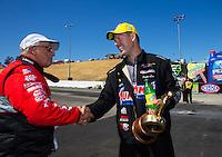 Jul. 27, 2014; Sonoma, CA, USA; Runner-up, V. Gaines (left) congratulates NHRA pro stock driver Jason Line after winning the Sonoma Nationals at Sonoma Raceway. Mandatory Credit: Mark J. Rebilas-