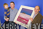 Brendan Kennelly Marketing Manager Kerry's Eye presents the prize to  winner of the John Hurley/Kerry's Eye painting Competition Chris Scannell from Muckross, Killarney also in photo is four old son Cian.