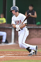 Elizabethton Twins left fielder Daniel Kihle (15) swings at a pitch during a game against the Johnson City Cardinals on July 30, 2015 in Elizabethton, Tennessee. The Twins defeated the Cardinals 13-4. (Tony Farlow/Four Seam Images)