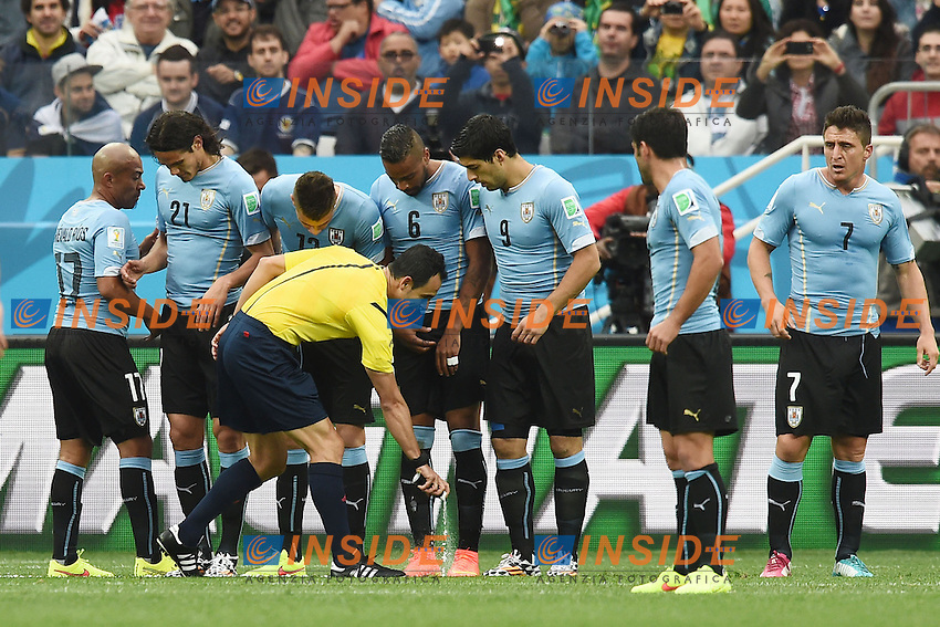 Referee with Spray. Arbitro <br /> Sao Paulo (Brasile)  19-06-2014 Arena Corinthians. Group D Uruguay - England / Uruguay - Inghilterra  . Football 2014 Fifa World Cup Brazil - Campionato del Mondo di Calcio  Brasile 2014 <br /> Foto Insidefoto