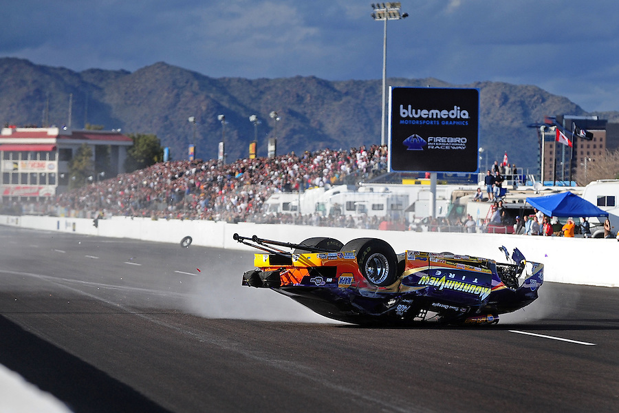 Feb. 20, 2010; Chandler, AZ, USA; NHRA pro stock driver Vinnie Deceglie crashes during qualifying for the Arizona Nationals at Firebird International Raceway. Mandatory Credit: Mark J. Rebilas-