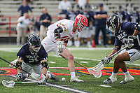 College Park, MD - February 25, 2017: Maryland Terrapins Austin Henningsen (18) fights for the loose ball during game between Yale and Maryland at  Capital One Field at Maryland Stadium in College Park, MD.  (Photo by Elliott Brown/Media Images International)