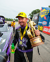Aug 19, 2018; Brainerd, MN, USA; NHRA funny car driver Jack Beckman celebrates after winning the Lucas Oil Nationals at Brainerd International Raceway. Mandatory Credit: Mark J. Rebilas-USA TODAY Sports