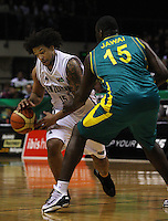 Tall Blacks forward BJ Anthony tries to get past Nathan Jawai during the International basketball match between the NZ Tall Blacks and Australian Boomers at TSB Bank Arena, Wellington, New Zealand on 25 August 2009. Photo: Dave Lintott / lintottphoto.co.nz