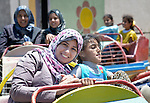A woman and her daughter, still traumatized by war, enjoy a trip to an amusement park in Gaza City. The outing was sponsored by the Al Ahli Arab Hospital, a member of the ACT Alliance, and financed by the Pontifical Mission for Palestine and Misereor.