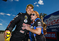 Aug 21, 2016; Brainerd, MN, USA; NHRA pro stock driver Drew Skillman (left) celebrates with Charlotte Lucas after winning the Lucas Oil Nationals at Brainerd International Raceway. Mandatory Credit: Mark J. Rebilas-USA TODAY Sports