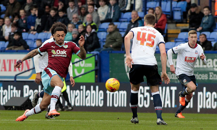 Burnley's Andre Gray takes on Bolton Wanderers' Rob Holding<br /> <br /> Photographer David Shipman/CameraSport<br /> <br /> Football - The Football League Sky Bet Championship - Bolton Wanderers v Burnley - Saturday 27th February 2016 - Macron Stadium - Bolton <br /> <br /> &copy; CameraSport - 43 Linden Ave. Countesthorpe. Leicester. England. LE8 5PG - Tel: +44 (0) 116 277 4147 - admin@camerasport.com - www.camerasport.com