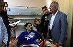 Palestinian Prime Minister Salam Fayyad visits the wounded Palestinians who injured during attack by Israeli settlers, at Rafidia hospital in the West Bank city of Nablus ,Tuesday, March 8, 2011. Jewish settlers opened fire Monday, wounding eight, Palestinians said. A Palestinian witness said villagers were tending to trees damaged by settlers when settlers attacked them, setting off a rock-throwing clash. Photo by Wagdi Eshtayah