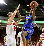 VERMILLION, SD - JANUARY 24: David Jenkins Jr. #5 from South Dakota State University takes the ball to the basket against Tyler Hagedorn #25 from the University of South Dakota during their game Wednesday night at the Sanford Coyote Sports Center in Vermillion, SD. (Photo by Dave Eggen/Inertia)