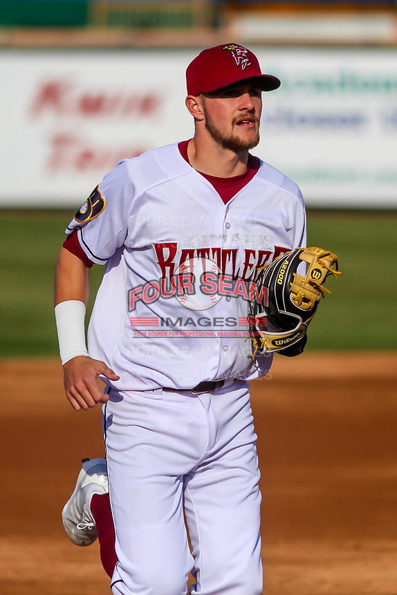 Wisconsin Timber Rattlers shortstop Brice Turang (2) jogs to the dugout between innings during a Midwest League game against the Burlington Bees on April 26, 2019 at Fox Cities Stadium in Appleton, Wisconsin. Wisconsin defeated Burlington 2-0. (Brad Krause/Four Seam Images)