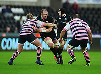 Ospreys' Alun Wyn Jones is tackled by Cardiff Blues&rsquo; Kristian Dacey<br /> <br /> Photographer Kevin Barnes/CameraSport<br /> <br /> Guinness Pro14 Round 13 - Ospreys v Cardiff Blues - Saturday 6th January 2018 - Liberty Stadium - Swansea<br /> <br /> World Copyright &copy; 2018 CameraSport. All rights reserved. 43 Linden Ave. Countesthorpe. Leicester. England. LE8 5PG - Tel: +44 (0) 116 277 4147 - admin@camerasport.com - www.camerasport.com