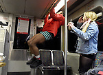 (Boston MA 01/07/18) If not standing out enough by not wearing any pants, James Evans of Somerville decides to do some pull-ups while riding on the redline, as Rosie Walker of Lowell, also a particpant, looks on, during the annual no pants subway ride, Sunday, January 7, 2018, in Boston. This is an annual global event started in New York in 2002. The brief ride through several lines lasted about 90 minutes and was smaller in numbers compared to the previous years organizers attributing that to the bone chilling weather. Herald Photo by Jim Michaud