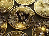 Close up of shiny new gold bitcoins