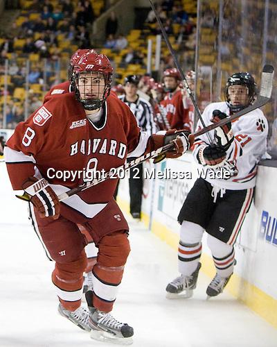 Patrick McNally (Harvard - 8) - The Harvard University Crimson defeated the Northeastern University Huskies 3-2 in the 2012 Beanpot consolation game on Monday, February 13, 2012, at TD Garden in Boston, Massachusetts.