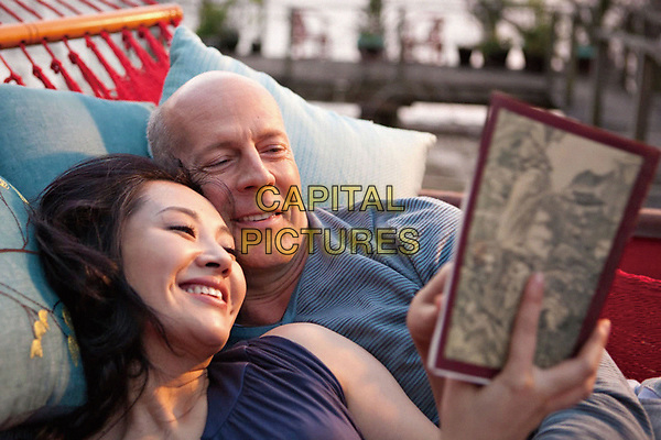 Looper (2012)<br /> Bruce Willis &amp; Xu Qing  <br /> *Filmstill - Editorial Use Only*<br /> CAP/KFS<br /> Image supplied by Capital Pictures