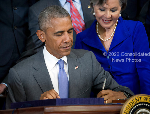 United States President Barack Obama signs H.R. 2576, the Frank R. Lautenberg Chemical Safety for the 21st Century Act in the South Court Auditorium of the White House in Washington, DC on Wednesday, June 22, 2016. The bill will establish standards for the use of certain toxic chemicals used regularly.  US Senator Barbara Boxer (Democrat of California) looks on from the right.<br /> Credit: Ron Sachs / CNP