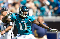 October 18, 2009:    Jacksonville Jaguars wide receiver Mike Sims-Walker (11) signals a first down after a completion during first half action between the NFC West St. Louis Rams and AFC South Jacksonville Jaguars at Jacksonville Municipal Stadium in Jacksonville, Florida............