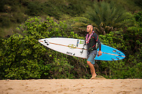 Waimea Bay, North Shore of Oahu, Hawaii.  December 4 2014) Shane Dorian (HAW). - The Opening Ceremony of the 2014 Quiksilver In Memory of Eddie Aikau contest was held this afternoon in the park at Waimea Bay. This winter, the big wave riding event celebrates a special milestone of 30 years. <br /> The Quiksilver In Memory of Eddie Aikau is a one-day big wave riding event that only takes place if and when waves meet a 20-foot minimum height, during the holding period of December 1 through February 28, each Hawaiian winter. The official Opening Ceremony with the Aikau Family will be held on Thursday, December 4th, 3pm, at Waimea Bay.<br />  <br /> &quot;The Eddie&quot; is the original big wave riding event and stands as the measure for every big wave event that exists in the world today. It has become an icon of surfing through its honor, integrity and rarity.<br />  <br /> The event honors Hawaiian hero Eddie Aikau, whose legacy is the respect he held for the ocean; his concern for the safety of all who entered it on his watch; and the way with which he rode Waimea Bay on its most giant and memorable days. <br />  <br /> Adherence to strict wave height standards has ensured its integrity; it is only held on days when waves meet or exceed the Hawaiian 20-foot minimum (wave face heights of approximately 40 feet). This was the threshold at which Eddie enjoyed to ride the Bay. It has been said that what makes The Eddie special is the times it doesn't run, because that is precisely its guarantee of integrity and quality days of giant surf.<br />  <br /> The competition has only been held a total of 8 times: it's inaugural year at Sunset Beach, and then seven more times at its permanent home of Waimea Bay. The Eddie was last held on December 9, 2009, won by California's Greg Long.   Photo: joliphotos.com