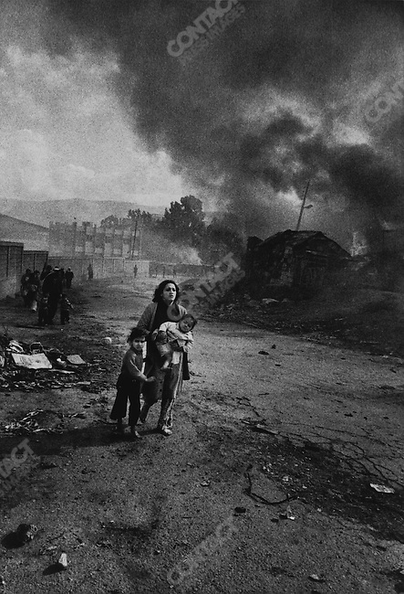 Paletinian mother and children fleeing massacre by Christian gunmen, Karantina, Beirut, Lebanon, January 18, 1976