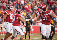 Hawgs Illustrated/BEN GOFF <br /> C.J. O'Grady (from left), Arkansas tight end, Devwah Whaley, Arkansas running back, and Hjalte Froholdt, Arkansas offensive lineman, celebate after Whaley scored a touchdown against Missouri in the third quarter Friday, Nov. 24, 2017, at Reynolds Razorback Stadium in Fayetteville.