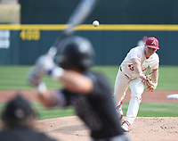 Arkansas' Kevin Kopps delivers a pitch to Grand Canyon University's Channy Ortiz Wednesday March 11, 2020 at Baum-Walker Stadium in Fayetteville. The Hogs won 10-9. Visit nwaonline.com/200312Daily/ for more images. (NWA Democrat-Gazette/J.T. Wampler)