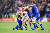 Picture by Allan McKenzie/SWpix.com - 09/03/2018 - Rugby League - Betfred Super League - Warrington Wolves v St Helens - Halliwell Jones Stadium, Warrington, England - St Helens' Louie McCarthy-Scarsbrook is tackled by Warrington's Daryl Clark, Ben Westwood & Ben Murdoch-Masila.