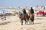 Horsemen at Punta Banda community at Ensenada, Baja California, Mexico